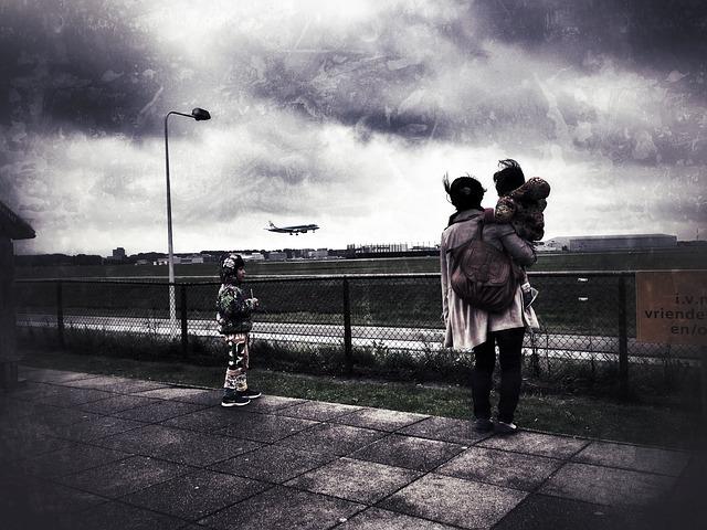 niños viaje avion